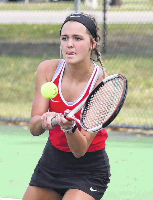 Bluffton's Pearl Lewandowski focuses on returning a shot during her doubles match at Celina High School Monday.