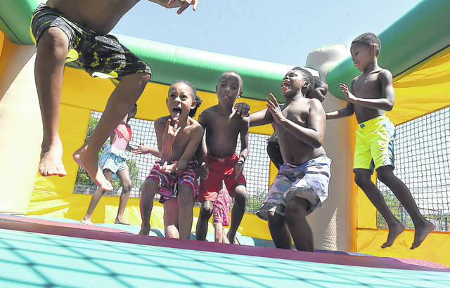 Area children enjoy a bouncy house during the last day of the summer program at the Bradfield Community Center. Children spent the day playing water games and other outdoor activities.