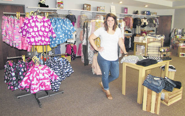 Allison Schroeder, owner of The Olive Tree Boutique, in Ottawa stands inside the new location of her business on Main Street next to First Federal Bank and across from Ottawa Post Office.