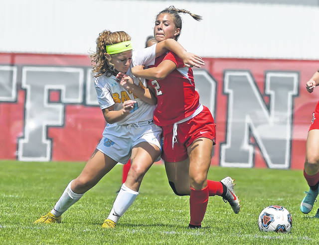 Bath's Chandler Clark, left, and Bluffton's Bella Basinger compete for the ball during Saturday's match at Steinmetz Field in Bluffton.