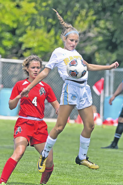 Bath's Abby Rakay controls the ball in front of Bluffton's Olivia Burner during Saturday's match at Steinmetz Field in Bluffton.