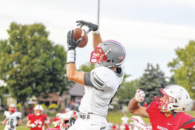 Columbus Grove's Ethan Halker hauls in a pass against Pandora-Gilboa's Bryce Basinger during Friday night's game in Pandora.