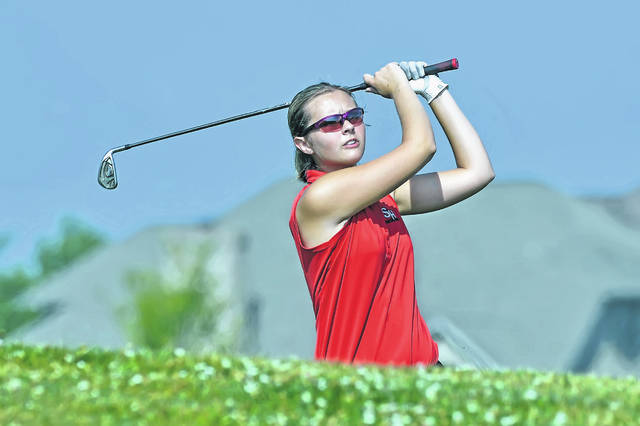 St. Henry's Ellen Naumann watches her shot on the 12th hole during Thursday's Celina Invitational at Celina Lynx Golf Club.