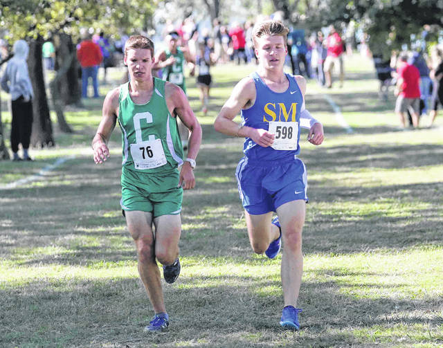 Celina's Jacob Klosterman (76) and St. Marys' Noah Tobin run side by side during Saturday's Celina Rotary Invitational on the Lake Campus of Wright State University.