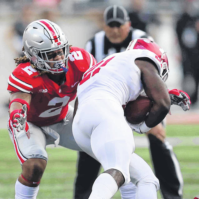 Ohio State defensive lineman Chase Young (2) prepares to wrap up Indiana running back Stevie Scott during the Buckeyes' game against the Hoosiers at Ohio Stadium last season.