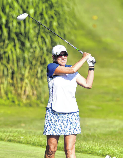 Connie Shutt watches her tee shot on 10th hole Friday during the Lima Area Women's Match Play tournament at Shawnee Country Club.