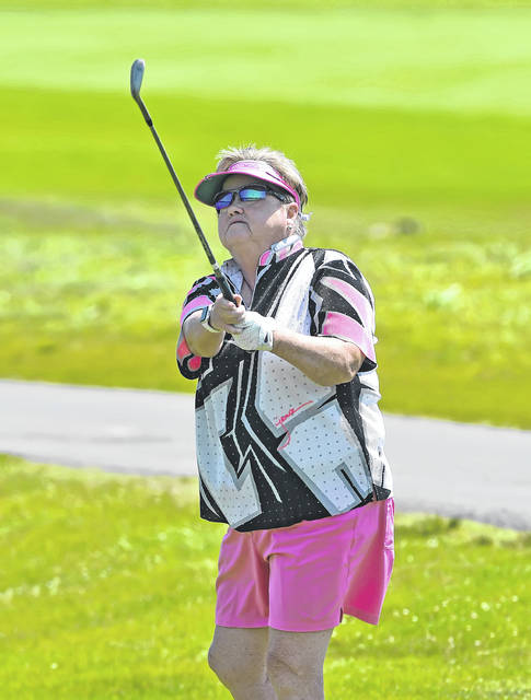 Joan Whittaker chips onto the second green Saturday during the Women's Match Play tournament at Hidden Creek Golf Club.