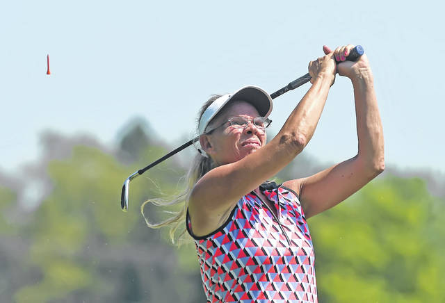 Deb Osburn watches her tee shot on the sixth hole Saturday during the Women's Match Play tournament at Hidden Creek Golf Club.