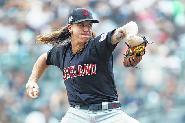 Cleveland Indians' starting pitcher Mike Clevinger winds up during the first inning of an 8-4 win over the New York Yankees on Sunday in New York. He struck out 10 hitters in the game.
