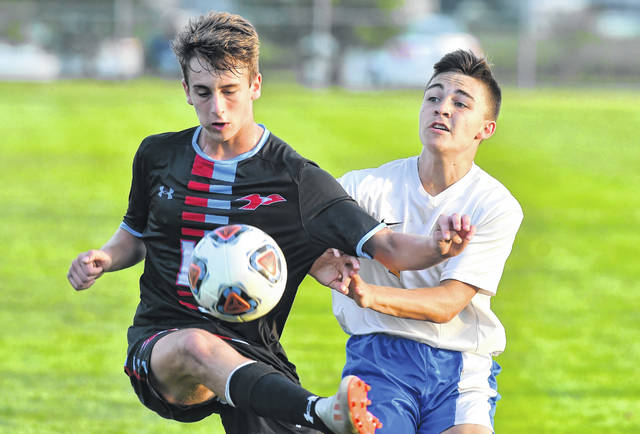 Continental's Wyatt Davis defends Lima Central Catholic's Michael Taflinger kicks away from during Thursday's Bath Kickoff Classic championship match.