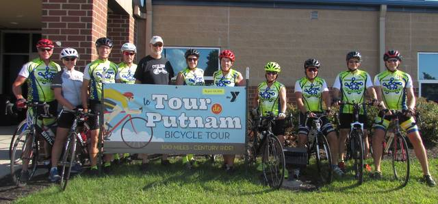 From left are Putnam County Cycling members next to a sign at the Putnam County YMCA promoting the Aug. 24 Tour De Putnam, Chuck Niese, Tammy Niese, Barney Beckman, Jeff Stechschulte, Ray Maxson, Beth Hartoon, Lori Painter, Jeanna Wiswasser, Terry Rigg, Dwight Schroeder and Chris Warnimont.