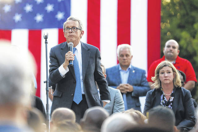 Gov. Mike DeWine said Ohio needs to do more while balancing people's rights to own firearms and have due process. (AP Photo/John Minchillo)