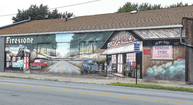 A mural in Delphos shows past businesses in the city.