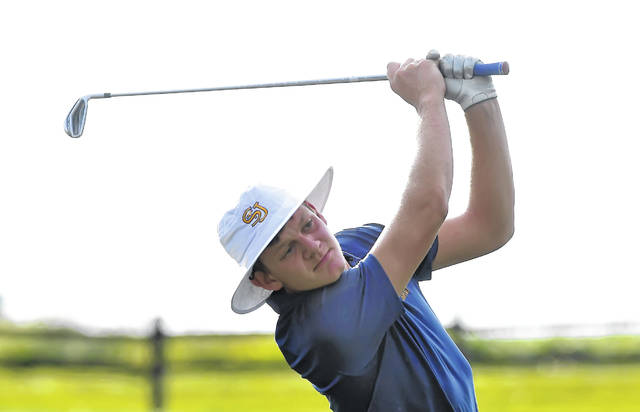 Jared Lucas of Delphos St. John's watches his shot on the ninth hole during Wednesday's dual match against New Knoxville at Delphos Country Club.