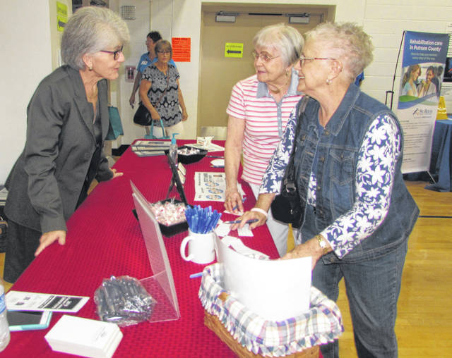 Anna Mae Blankeyer, partner for Schroeder, Blankenship and Schroeder, talks to friends Ruth Drerup and Jane Klemm, both of Ottawa, during the Senior Expo at Ottawa Elementary.