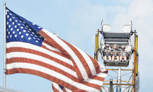 Fairgoers react while riding the Ferris wheel at last year's Allen County Fair.