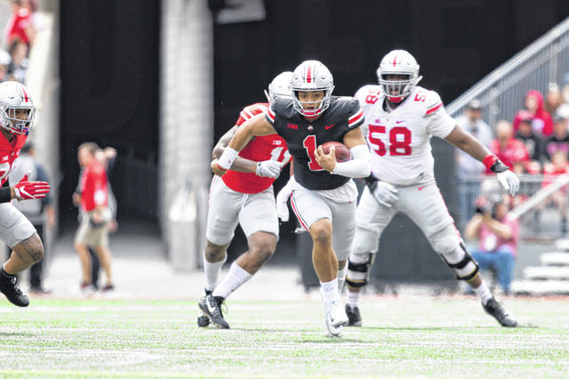 Ohio State quarterback Justin Fields, shown running the ball during the Buckeyes' spring game in April, was named on Monday as OSU's starting quarterback for its opener against Florida Atlantic on Aug. 31 at Ohio Stadium.