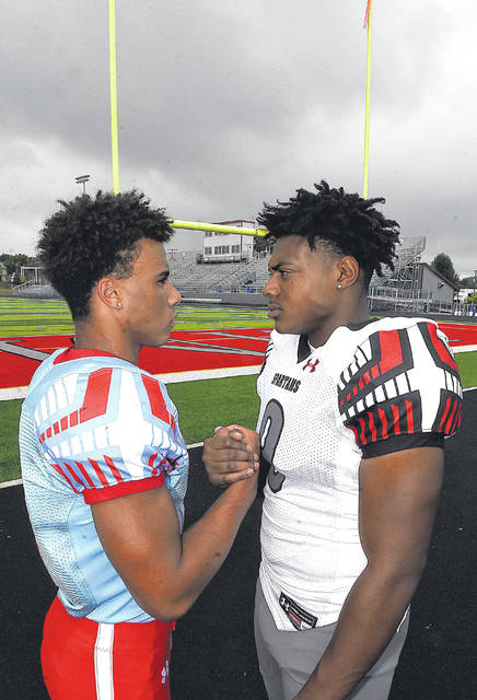Lima Central Catholic's Shawn Thomas, left, and Lima Senior's Caymian Durr are friends and will be rivals Thursday night when the Spartans and Thunderbirds clash on the gridiron for the first time.