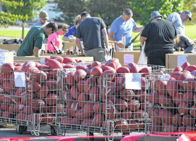 Hundreds of people checked out the Wilson Football Factory's annual garage sale, Saturday.