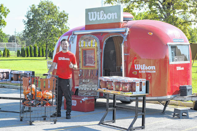 Corin Chesterson, marketing specialist for Wilson Sporting Goods, poses in front of the company's custom Airstream.