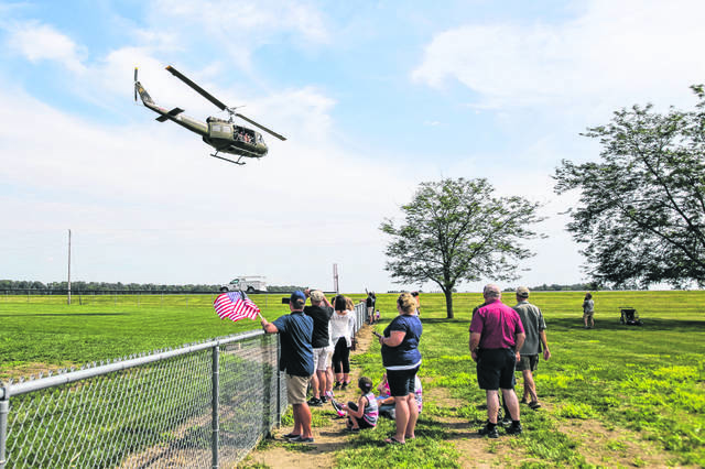 Spectators watch the helicopters fly by during the kick off to the Fort Fest last year.