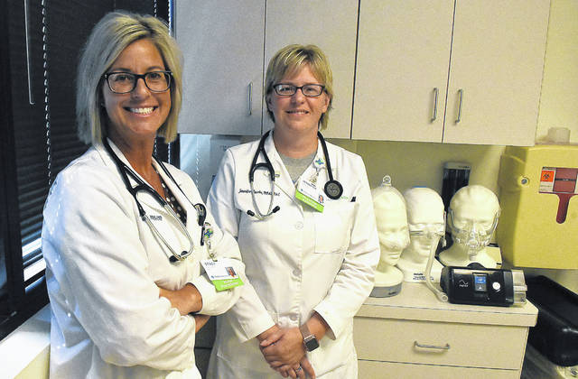 Stacy Friesner, left, and Jennifer Jacobs at St. Rita's Pulmonary office in Lima. Craig J. Orosz   The Lima News