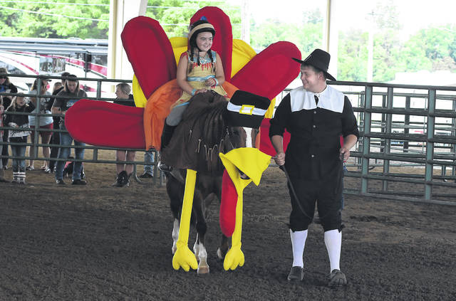 Dressed in costumes as a Native American and pilgrim is Chloe Agler, 9, and Dustin Lauck walking a turkey horse named Harley during the Allen County Fair Junior Fair Horse & Pony Costume Class on Thursday.
