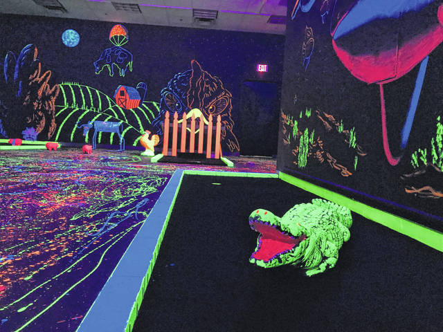 Glo Golf, an indoor miniature golf course at the Lima Mall on Elida Road, hired a Denver artist to design the course's colorful murals. Each hole has its own theme.