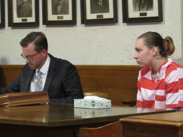 Jessica McClure, right, is pictured with her attorney, Alex Treece, in Putnam County Common Pleas court.