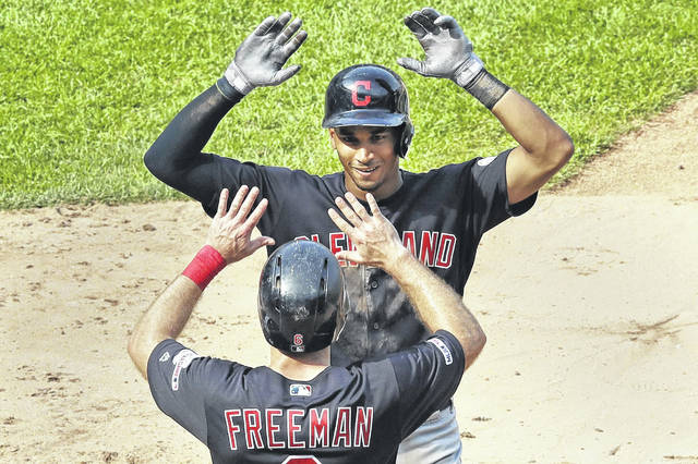 Cleveland Indians' Oscar Mercado, top, celebrates with Mike Freeman (6) after hitting a two-run home run during the eighth inning of a baseball game against the New York Yankees, Sunday, Aug. 18, 2019, in New York. (AP Photo/Kathy Willens)
