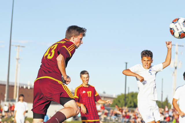 Kalida's Drew Fersch of Kalida heads the ball into the back of the net during Friday's game against Defiance at Kalida.