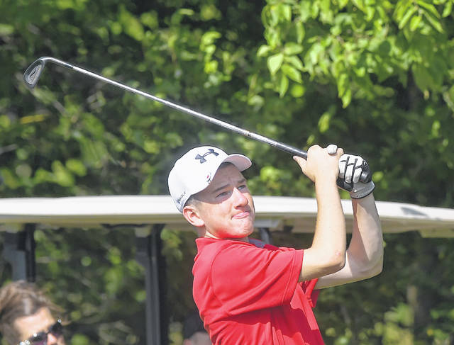 Pandora-Gilboa's Trey Hovest watches his tee shot on the 14th hole during Thursday's dual meet against Lima Senior at Bluffton Golf Club.