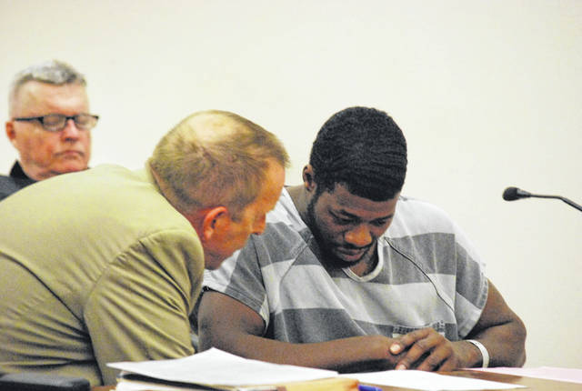 Lameka Kitchen confers with his attorney, Kenneth Rexford, during a change of plea hearing Tuesday in Allen County Common Pleas Court. Prosecutors said additional evidence in the case resulted in a reduction of the charges against Kitchen.