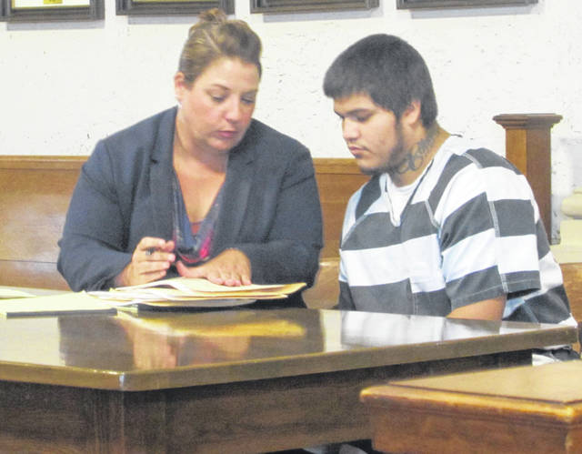 Isaiah Oliver, 18, appeared in court before Putnam County Common Pleas Judge Keith Schierloh Thursday. A trial date was set for the man accused of armed robbery.