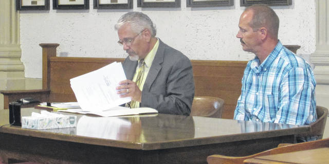 From left are Attorney E. Charles Bates representing his client Continental resident Michael T. Huizenga who has been charged with seven counts of rape and four counts of gross sexual imposition and will stand trial in October.