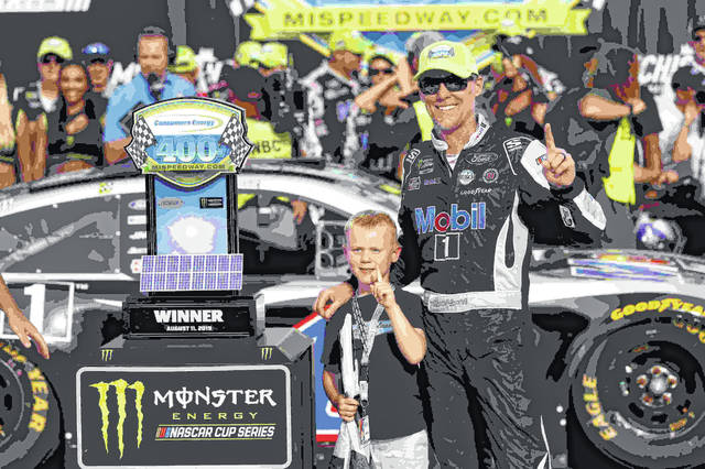 Kevin Harvick celebrates with his son, Keelan, after winning a NASCAR Cup Series auto race at Michigan International Speedway in Brooklyn, Mich., Sunday.