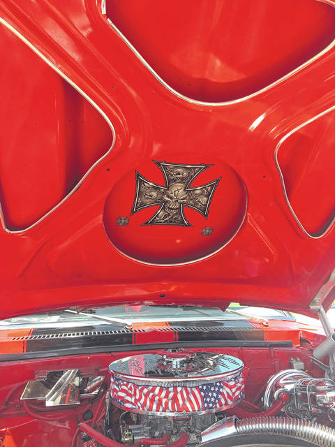 The skull and crossbones under the hood adds to the rebel mystic of Dan Fifer's 1972 Chevy Nova SS.