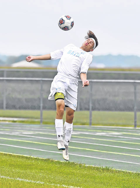 Bath's Keaton Liles heads the ball against Ottoville during Monday's match at Ottoville High School.