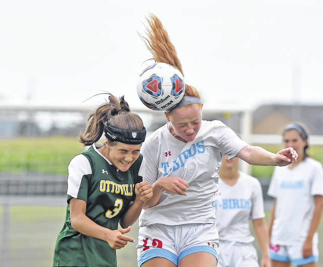 Ottoville's Alyson Saxton, left, and Lima Central Catholic's Annika Wilker compete for a header during Saturday's match at Ottoville High School.