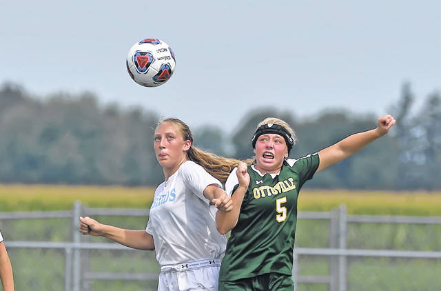 Lima Central Catholic's Olivia Stolly, left, and Ottoville's Becca Turnwald compete for the ball during Saturday's match at Ottoville High School.