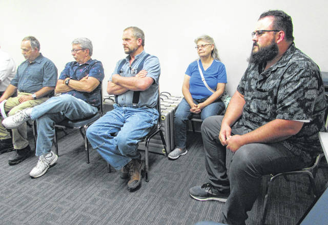Pictured are Sugar Creek and Blanchard Township residents who attended a meeting to express their opposition to polling sites being closed and moved in their towns.