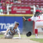 Cardinals build 5-1 lead, hold off Reds