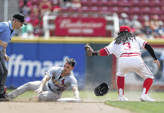 St. Louis Cardinals runner Lane Thomas, left, is tagged out by Cincinnati Reds second baseman Freddy Galvis during the fourth inning of Sunday's game at Great American Ball Park.