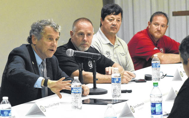 U.S. Sen. Sherrod Brown (D-OH), left, speaks at a roundtable discussion on his Workers' Right to Training Act at UAW Local 1219 hall in Lima on Friday. Seated with Brown are local UAW presidents Mike Copeland, Bryan McClurg and Chad Aregood.