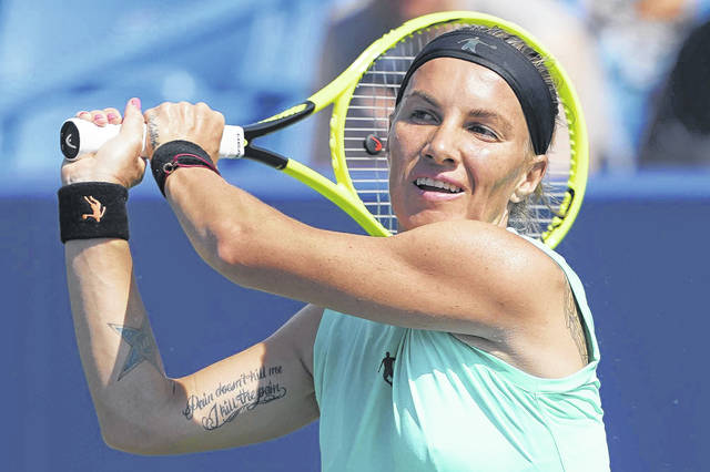 Svetlana Kuznetsova, of Russia, returns to Ashleigh Barty, of Australia, during the Western & Southern Open tennis tournament, Saturday, Aug. 17, 2019, in Mason, Ohio. (AP Photo/John Minchillo)