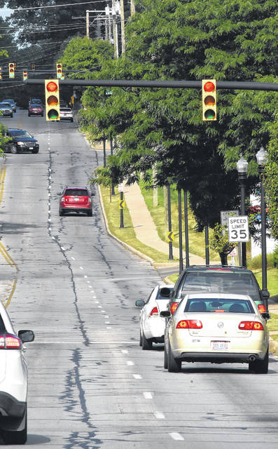 Stop-and-go traffic along Market Street rolls past St. Rita's Medical Center.