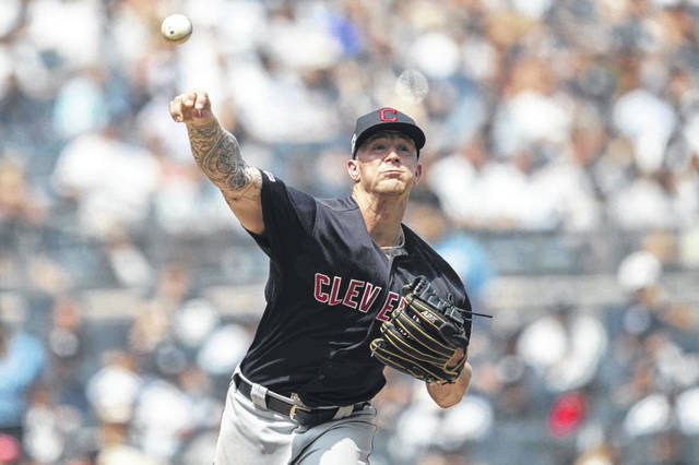 Cleveland Indians starting pitcher Zach Plesac throws to first on a pick off attempt against New York Yankees' Cameron Maybin during the second inning of a baseball game, Saturday, Aug. 17, 2019, in New York. (AP Photo/Mary Altaffer)