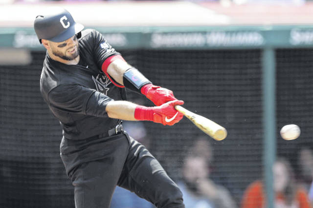 Cleveland Indians' Kevin Plawecki hits an RBI-single in the seventh inning of a baseball game against the Kansas City Royals, Sunday, Aug. 25, 2019, in Cleveland. Yu Chang scored on the play. (AP Photo/Tony Dejak)