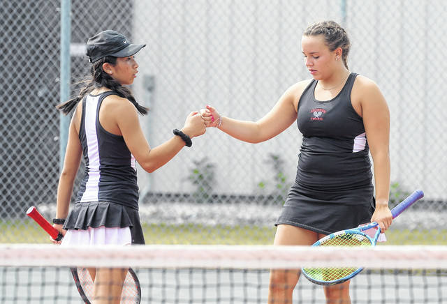 Shawnee's Alotus Wei, left, and Katie Clark celebrate winning a point against Lima Central Catholic's Anna Janowski and Madie Brinkman during Saturday's Wapakoneta Invitational.