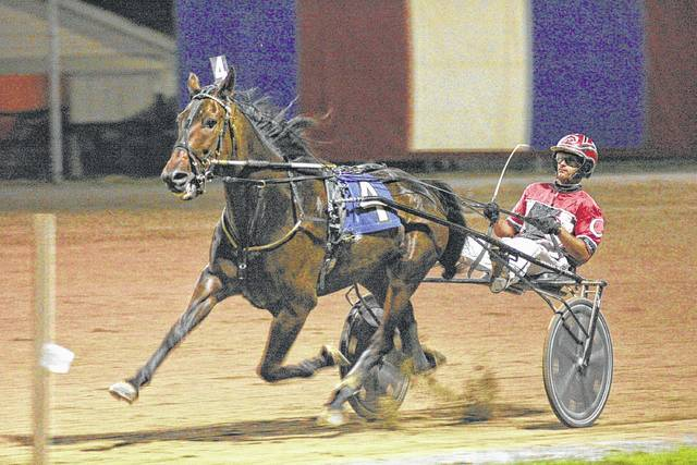 Wishin Iwas Fishin, driven by Scott Cisco, competes in a past Allen County Super Trot at the Allen County Fairgrounds.